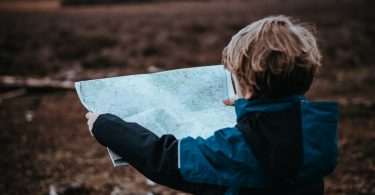 kid boy holding map