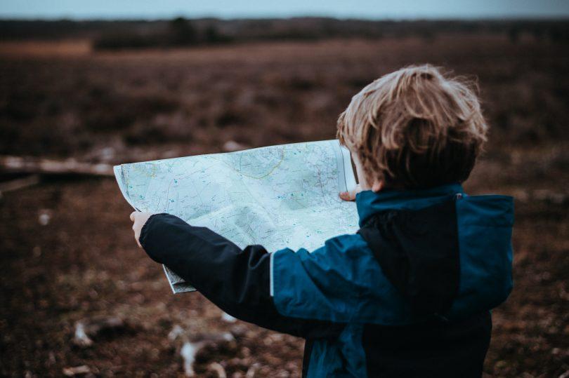 kid boy holding map