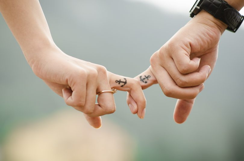couple fingers anchor tattoo