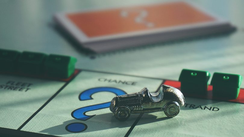 car on question mark monopoly board