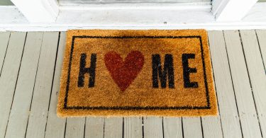 welcome mat says home with heart