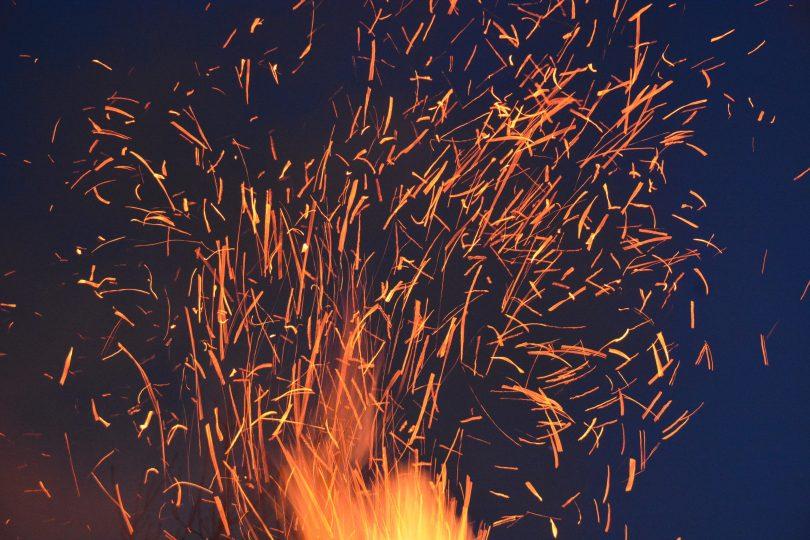fire sparks night sky