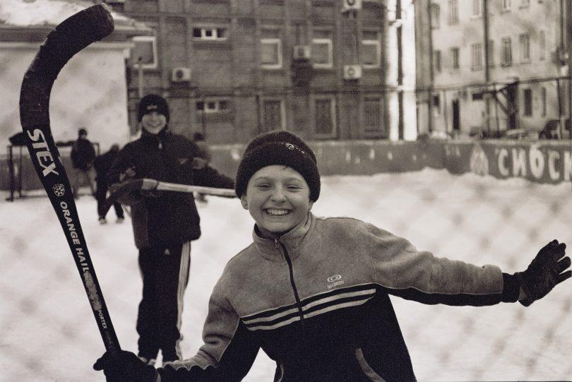 sepia boy smile hockey