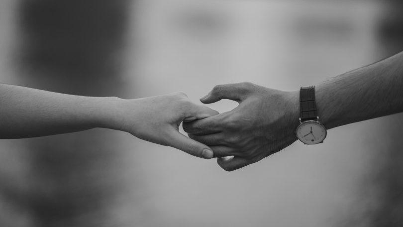 hands gentle hold reach
