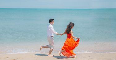 couple running on shore