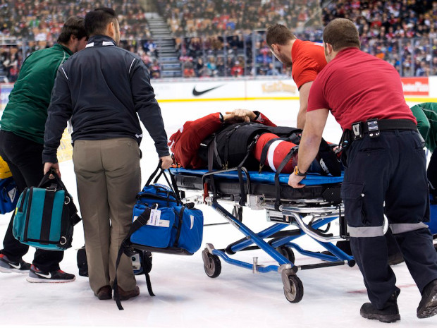 Switzerland forward Phil Baltisberger leaves the ice on a stretcher while playing against Russia during second period preliminary round hockey action at the IIHF World Junior Championships in Toronto on Sunday, December 28, 2014. THE CANADIAN PRESS/Nathan Denette