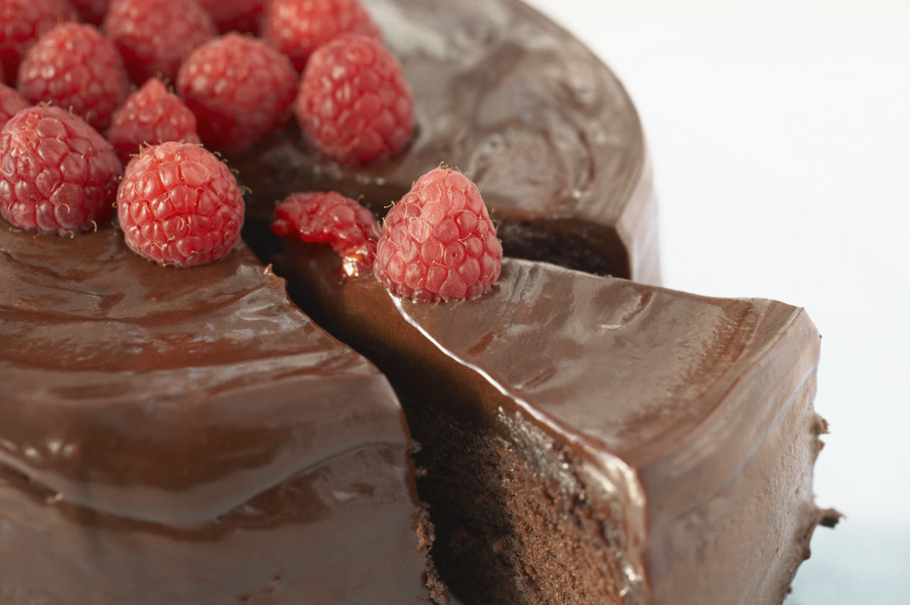 Chocolate Cake Slice with Raspberries --- Image by © Royalty-Free/Corbis