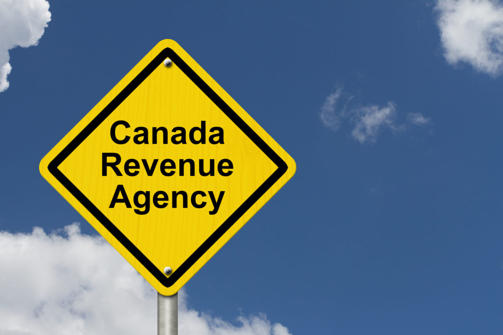 Canada Revenue Agency Warning Sign, A Canadian road warning sign with words Canada Revenue Agency with a sky background