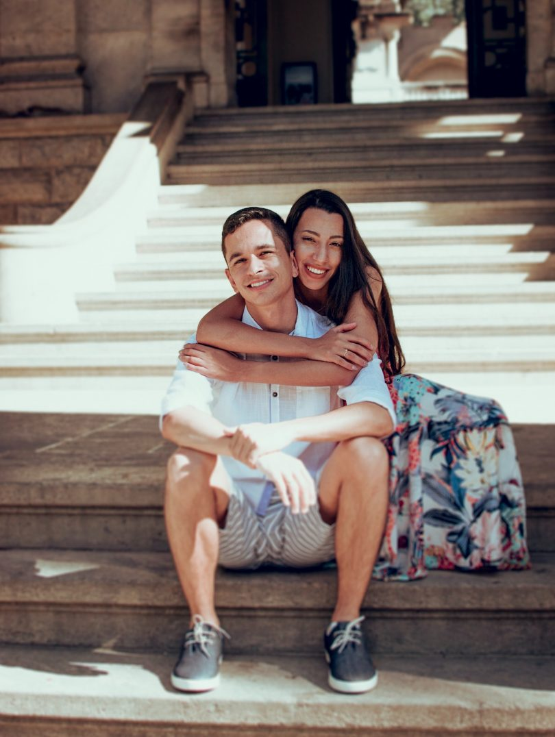 couple love happy sitting on steps