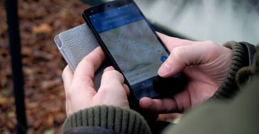 Person-Using-Google-Maps-Application-Through-Black-Android-Smartphone