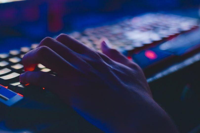 hand on keyboard in dark