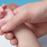 Father holding child hand