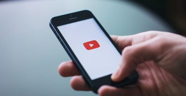 mobile phone in hand youtube loading screen