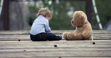 kid and teddy bear